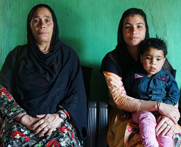 From left, Abrar Ahmed Chauhan's mother, Malika Khatoon; widow, Shareen Akthar; and two-year-old son Anish. Abrar and two of his cousins were reportedly killed in a July 2020 encounter with the Indian army, who claimed the men were foreign militants.