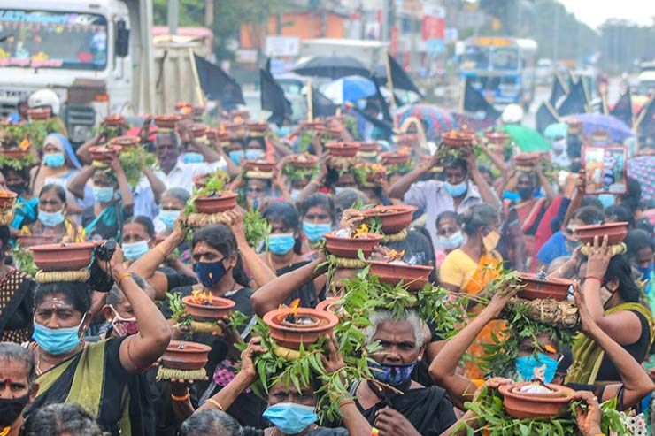 Security forces in the Northern and Eastern Provinces of Sri Lanka continue to commit atrocity crimes such as enforced disappearances and torture. Here, mothers and fathers protest the disappearance of children by placing pots with burning coals on their heads as a sign of commitment.