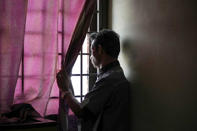 Zafar Ahmad Abdul Ghani of the Myanmar Ethnic Rohingya Human Rights Organisation Malaysia looks out from his home in Kuala Lumpur. Misinformation and messages of hate have left the Rohingya refugee and activist with debilitating depression.